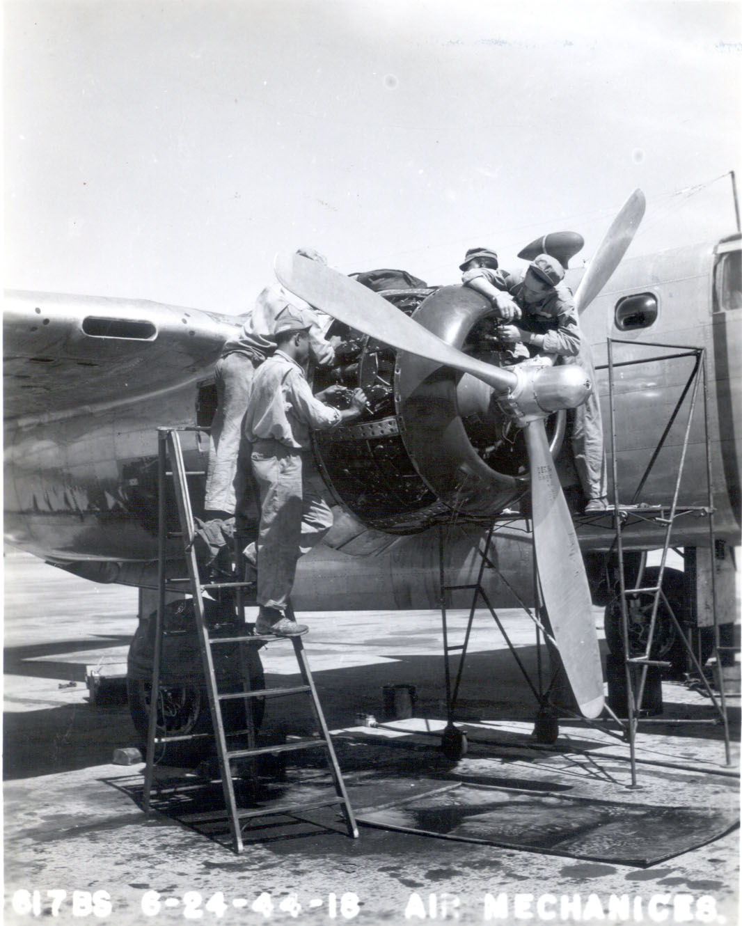 Mechanics work on aircraft